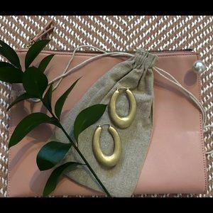 Gold oval hoop earrings, matte textured